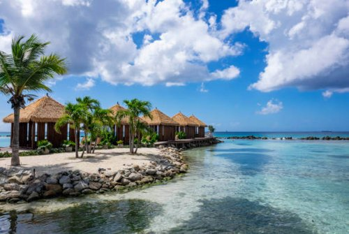 Picturesque Renaissance Islands of Aruba with Turquoise Waters, Swaying Palm Trees and Private Gazebos